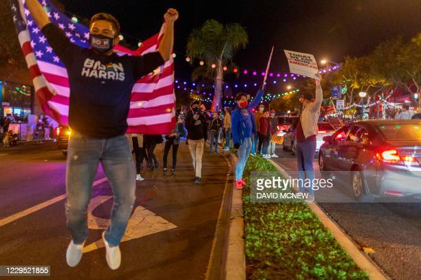 People celebrate the victory of Joe Biden and Kamala Harris in the 2020 presidential election in West Hollywood California on November 7 2020...