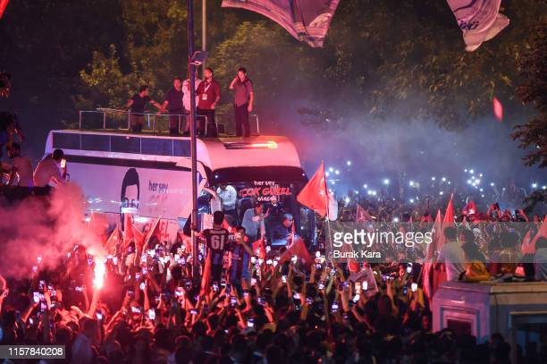 People celebrate the victory of mayoral candidate Ekrem Imamoglu of the Republican People's Party after Binali Yildirim of the ruling Justice and...