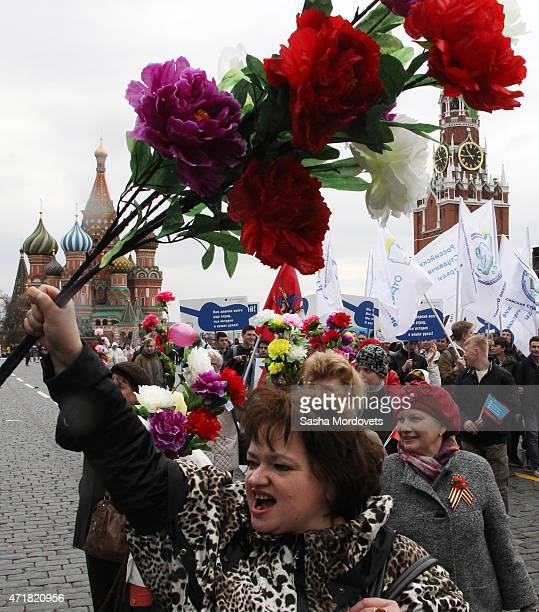 People celebrate with flags balloons music dance and antiUS posters on Red Square during a Soviet style rally of Russian trade unions on May 1 2015...