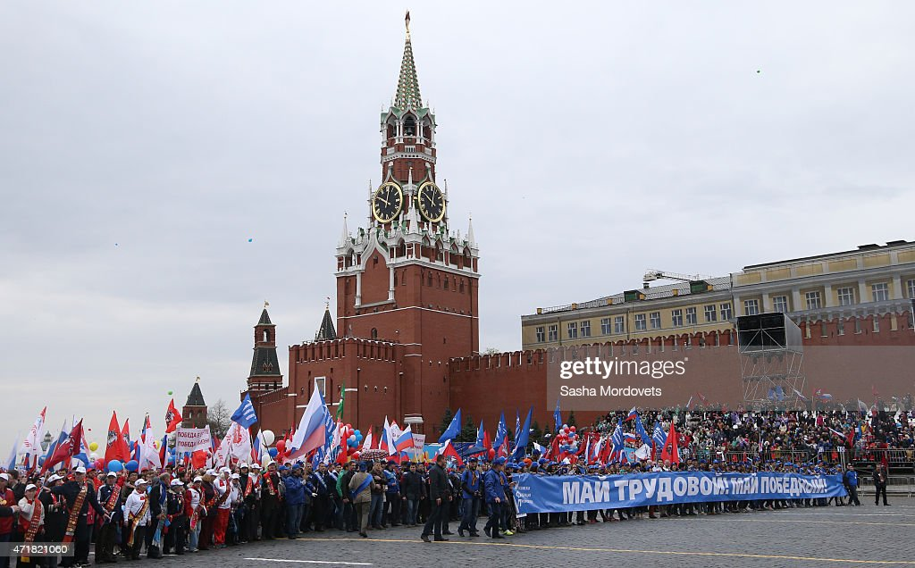 People celebrate with flags, balloons, music, dance and anti-U.S. posters on Red Square during a Soviet style rally of Russian trade unions on May 1, 2015 in Red Square in Moscow, Russia. Some 140,000 workers and students attended the parade on occasion of Labour Day, also known as International Worker's Day or May Day.
