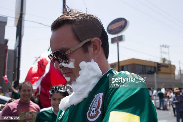 People celebrate with foam after winning their FIFA World Cup Group F South Korea vs Mexico match on June 23 2018 in Mexicali Mexico