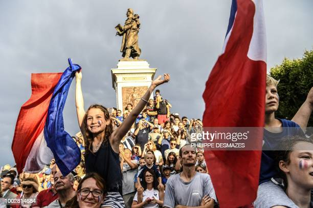 People celebrate with French football player Antoine Griezmann in his hometown of Macon eastern France on July 20 after France won the Russia 2018...