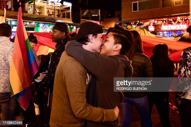 People celebrates after the Ecuador's Constitutional Court approved equal civil marriage, in Quito, on June 12, 2019. - Ecuador's highest court on...