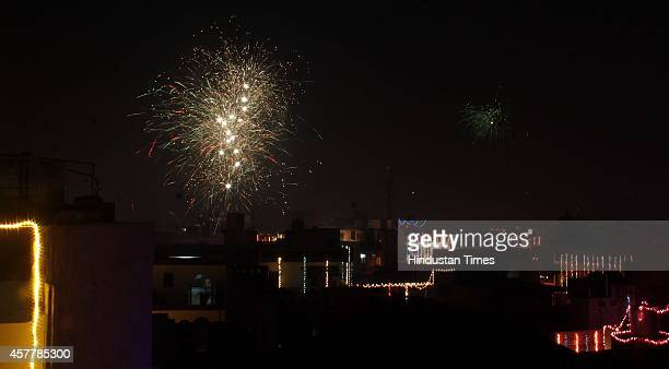 People celebrates Diwali festival on October 23 2014 in Gurgaon India Diwali the festival of lights was celebrated with traditional fervour across...