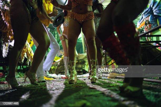 people celebrating and dancing brazilian carnival - human foot stock pictures, royalty-free photos & images