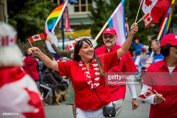 people celebrating canada day. - canada day stock pictures, royalty-free photos & images