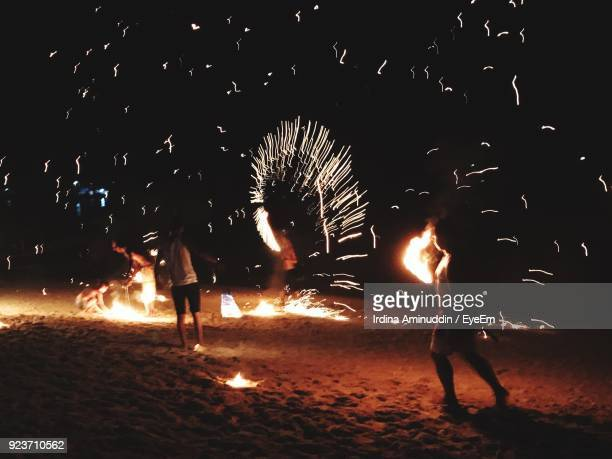 people celebrating diwali at night - diwali stock photos and pictures