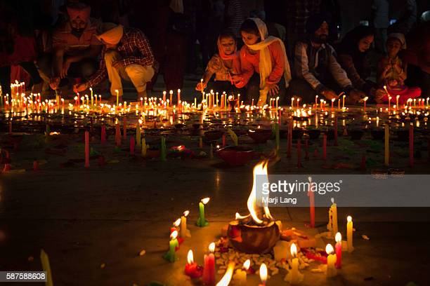 People celebrating Diwali festival night also Bandi Chhor Divas celebration for the Sikh religion followers at the Gurdwara Dukh Nivaran Sahib in...