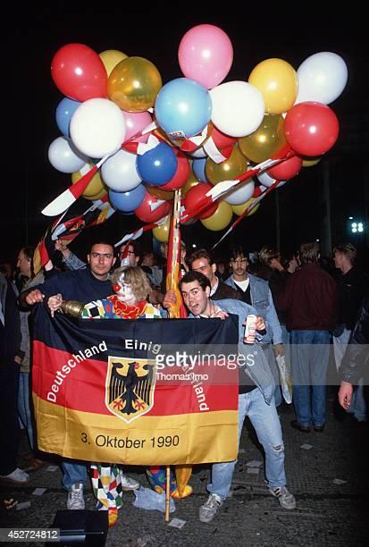 People celebrating German Unity Day in Berlin, Germany 3rd October 1990.