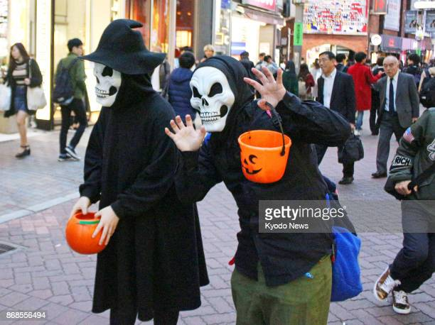 People celebrating Halloween pose for photos in Tokyo's Shibuya district on Oct 31 2017 ==Kyodo