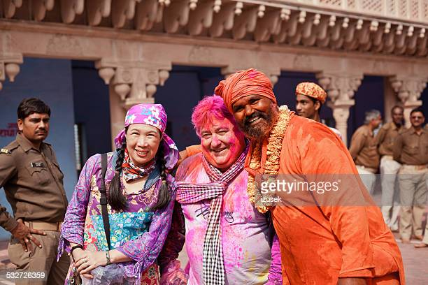 people celebrating holi fest in india - izusek stock pictures, royalty-free photos & images