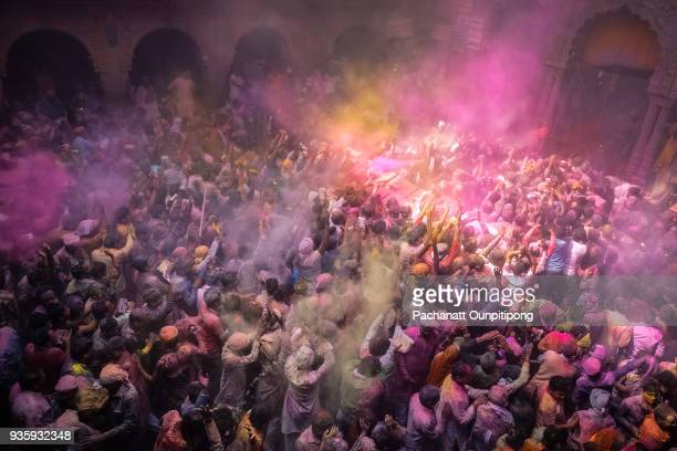 people celebrating holi festival in mathura city - lord krishna stock photos and pictures