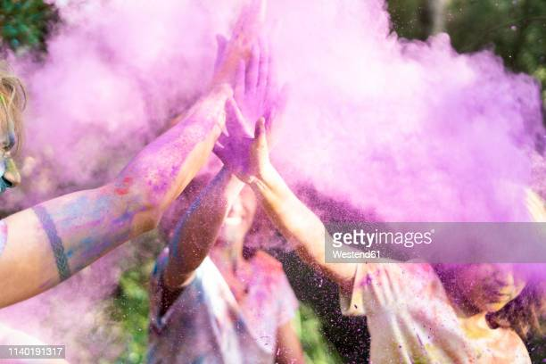 people celebrating holi, festival of colors - magenta stock pictures, royalty-free photos & images