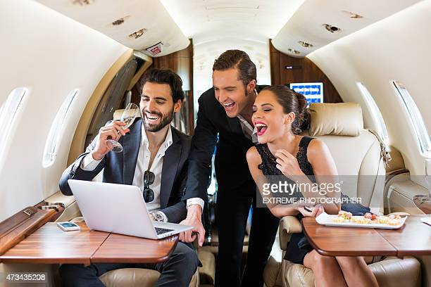 People celebrating in first class