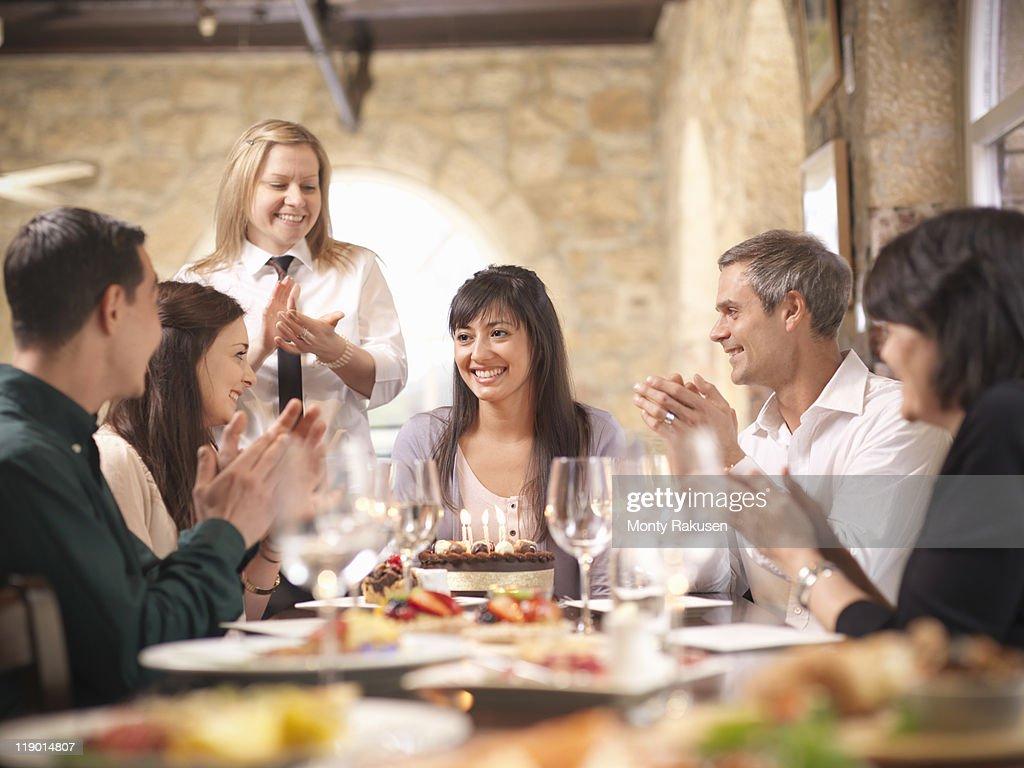 People celebrating in restaurant : Stock Photo