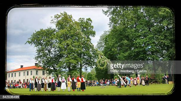 people celebrating midsummer eve - maypole stock pictures, royalty-free photos & images