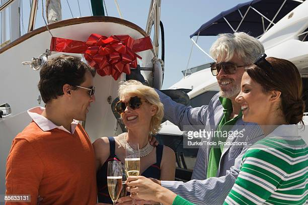 People celebrating new yacht with champagne