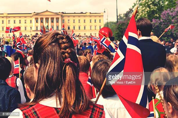 people celebrating norwegian festival - norwegian flag stock pictures, royalty-free photos & images