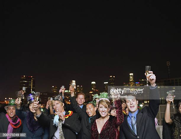 people celebrating on rooftop at new years eve party, portrait - 25 29 years stock pictures, royalty-free photos & images
