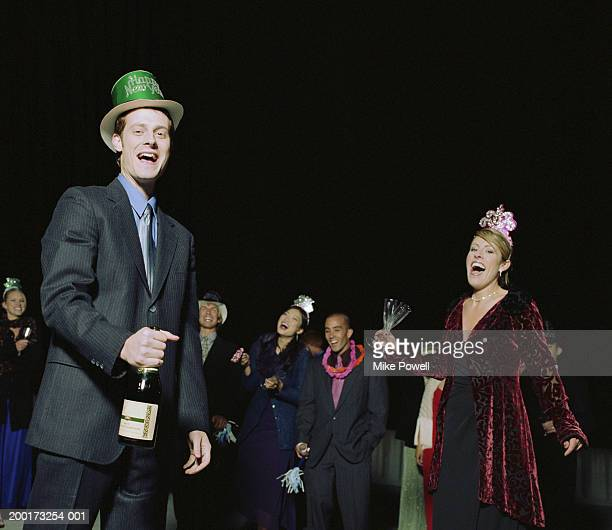 people celebrating on rooftop at new years eve party, portrait - 30 34 years stock-fotos und bilder