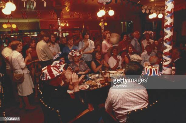 People celebrating Prince Charles and Lady Diana Spencers royal wedding 29th July 1981
