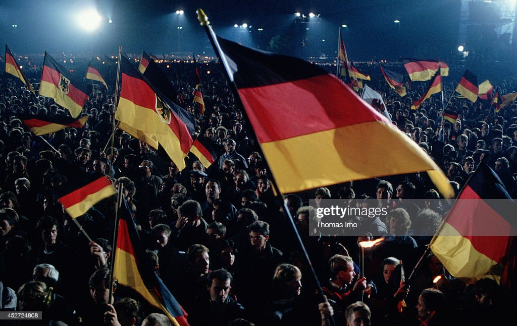 People celebrating the German Unity Day and are waving German Flags on October 03, 2014, in Berlin, Germany. The year 1990 marks the 25th anniversary of the fall of the Berlin Wall.