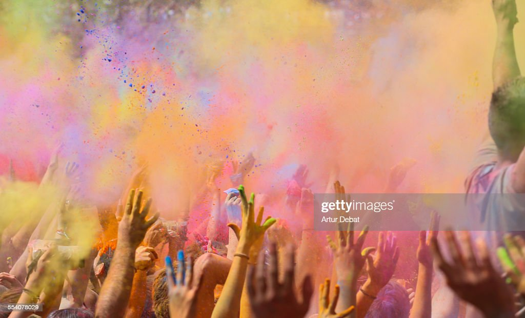 People celebrating the holi festival in Barcelona. : Stock Photo