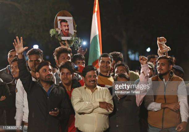 People celebrating the release of IAF pilot Abhinandan Varthaman at India Gate on March 1 2019 in New Delhi India Wing Commander Abhinandan Varthaman...