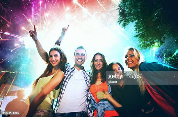 People celebrating with fireworks.