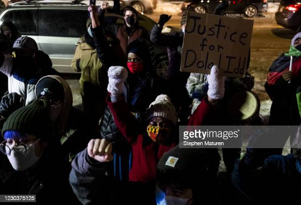 People chant an Assata Shakur quote to close out a vigil held at Holiday gas station, where Dolal Idd was shot and killed by Minneapolis Police, on...