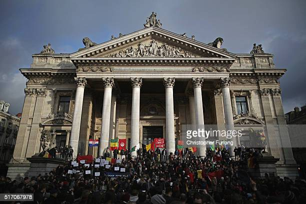 People chant and sing songs at the Place De La Bourse in honour of the victims of yesterdays' terror attacks on March 23 2016 in Brussels Belgium...