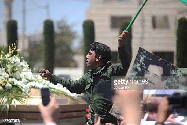 People chant at the funeral for Tariq Aziz former Iraqi deputy prime minister and top aide of Saddam Hussein at Al Khuloud cemetery on June 13 2015...