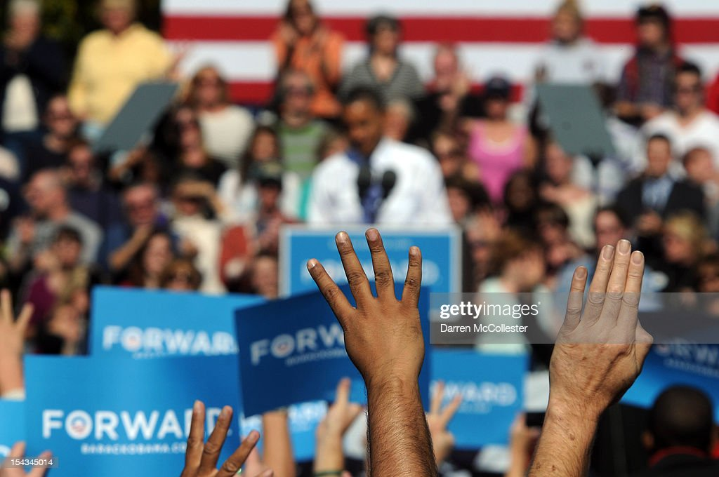 People chant, 'Four more years,' as President Barack Obama speaks at an event at Veteran's Memorial Park October 18, 2012 in Manchester, New Hampshire. President Obama continues to campaign in swing states with just under three weeks left till Election Day.
