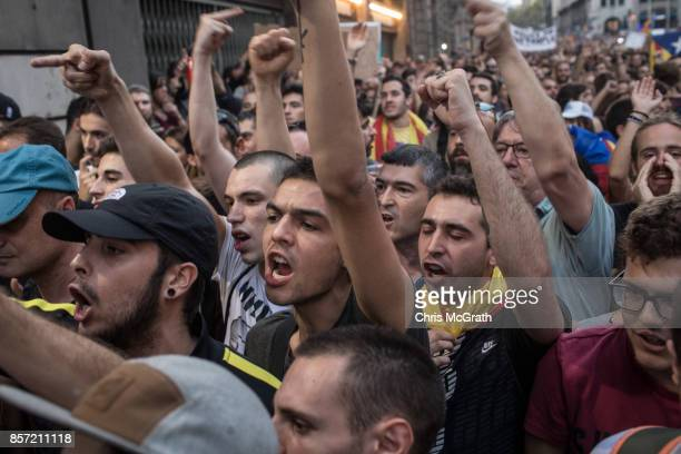 People chant slogans and gesture towards members of the Spanish National Police outside the General Direction of the National Police of Spain...
