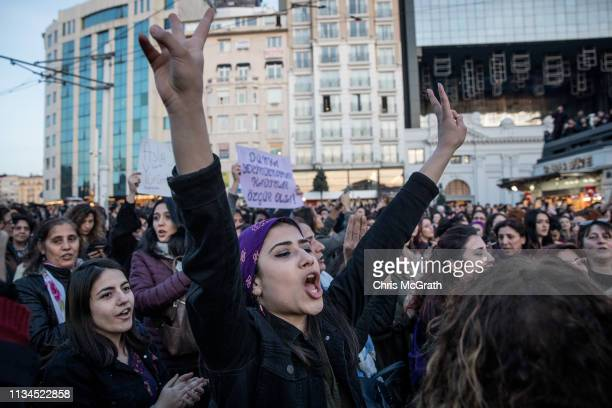 People chant slogans and sing songs as thousands of people attempt to march down Istanbul's famous Istiklal street during a rally for International...