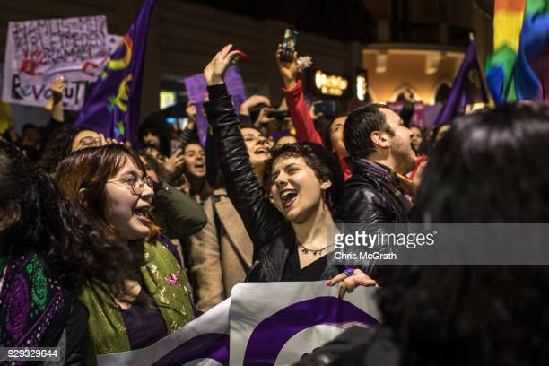 People chant slogans as they march down Istanbul's famous Istiklal street during a rally for International Women's Day on March 8 2018 in Istanbul...