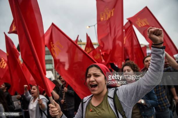 People chant slogans as they march with the red flags of the Turkish communist party the Communist Movement of Turkey while they gather in Bakirkoy...