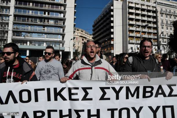 People chant slogans as they take part in a 24hour general strike in Athens on December 14 2017 The strike has paralysed the civil service trains and...