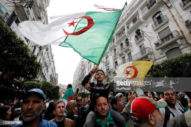 People chant slogans at a weekly anti-government demonstration in the capital Algiers on March 13, 2020. - Algeria has recorded two deaths from the...