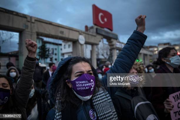 People chant slogans during a protest against Turkey's decision to withdraw from the Istanbul Convention on March 24, 2021 in Istanbul, Turkey....