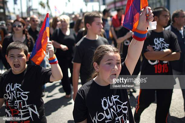 People chant while marching on the 99th anniversary of the Armenian Genocide calling for recognition and reparations on April 24 2014 in Los Angeles...