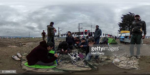 People charge their mobile phones at the Idomeni refugee camp on the Greek Macedonia border on March 16 2016 in Idomeni Greece The decision by...
