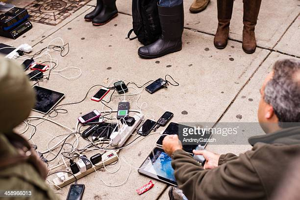 People charging mobile devices after hurricane Sandy