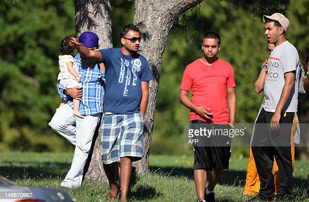 People chat near the Sikh Temple of Wisconsin where at least one gunman fired upon people at a service on August 2012 Oak Creek Wisconsin At least...