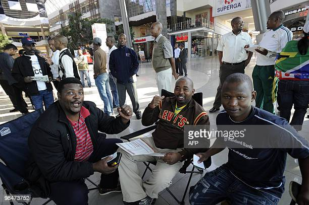 People chat on their chairs as they queue to purchase official 2010 FIFA World Cup tickets on April 15 2010 at the Maponya shopping mall in Soweto...