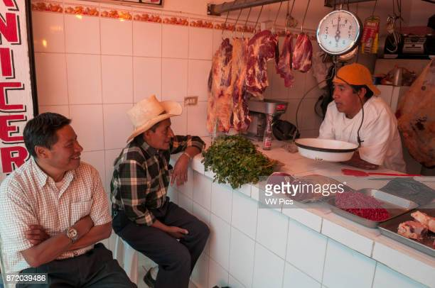 People chatting with the butcher in Salcaja