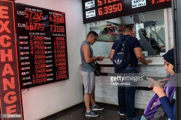 People check currency exchange rates at a currency exchange office on August 11 2018 in Istanbul President Recep Tayyip Erdogan vowed on August 11...