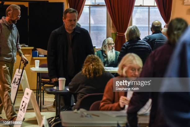 People check in to vote at the Montpelier Town Hall on November 6, 2018 in Montpelier, Vermont. Turnout is expected to be high nationwide as...