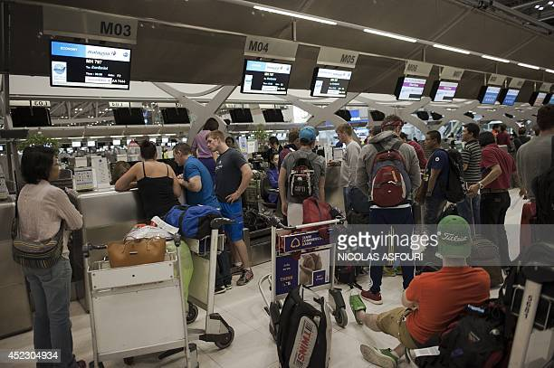 People check into their Malaysia Airlines flight bound for Kuala Lumpur at Bangkok's Suvarnabhumi airport early on July 18 2014 A Malaysian airliner...