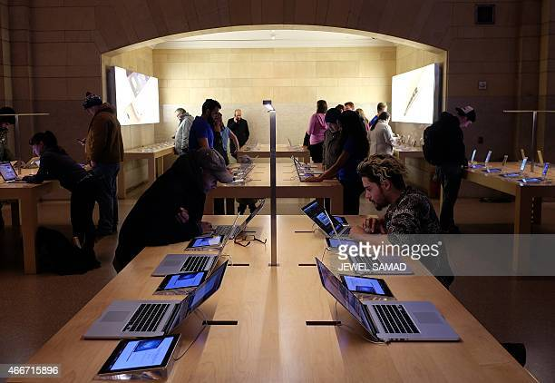 People check out Apple products in an Apple store at Grand Central Station in New York on March 18 2015 AFP PHOTO/JEWEL SAMAD